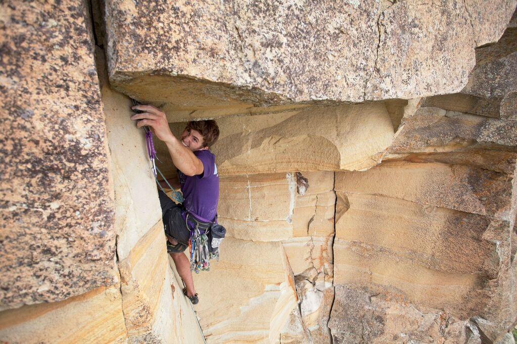 The author climbing on Square Butte, North Dakota. Photo: Matthew Eckelberg